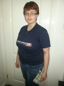 Photo of me, wearing a Mass Effect t-shirt and modelling my new Kobo case